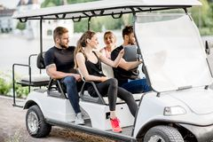 Friends in the golf cart Royalty Free Stock Photography