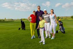 Friends golfers with kid happy to finish their golf game stock photo