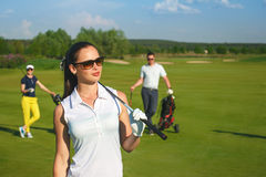 Friends golfers playing golf Stock Photography