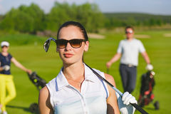 Friends golfers playing golf Stock Photos