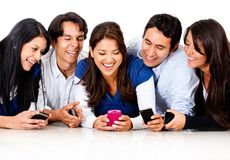 Friends gossiping on a cell phone Stock Images
