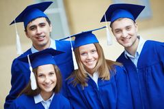 Friends in graduation gowns Royalty Free Stock Photos