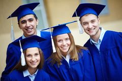 Friends in graduation gowns Stock Images