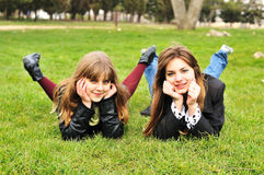 Friends in grass stock photos