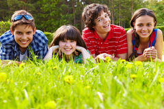 Friends on grass Royalty Free Stock Photos