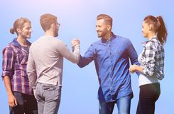 Friends greet each other with a handshake. Photo with copy space royalty free stock photos