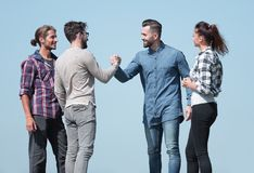Friends greet each other with a handshake. Photo with copy space royalty free stock image
