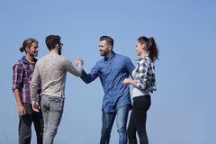 Friends greet each other with a handshake. Photo with copy space stock image