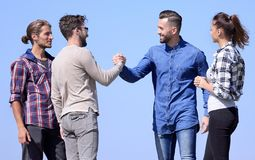 Friends greet each other with a handshake. Photo with copy space stock photos
