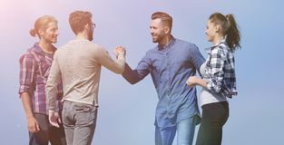 Friends greet each other with a handshake. Photo with copy space stock photography