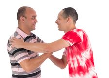 Friends greet each other warmly. Handshake. White background. stock photo