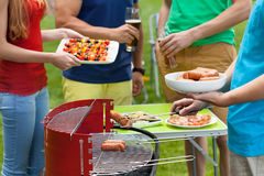 Friends grilling in a garden Stock Images