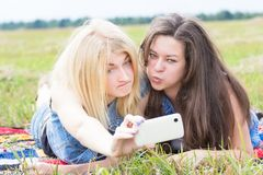 Friends grimacing and making selfie Royalty Free Stock Images