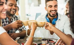 Friends group drinking latte at coffee bar restaurant - People t. Alking and having fun together at fashion cafeteria - Friendship concept with happy men and stock image