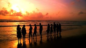 Friends. A group of friends enjoying the sun set in a beach Royalty Free Stock Photos