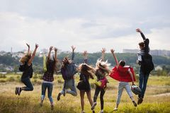 Friends group happy jumping nature concept. Tourist happiness. Active lifestyle Stock Photos