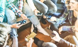Friends group having addicted fun together using mobile smart phones. Friends group having addicted fun together using modern smartphone - Hands sharing content stock images