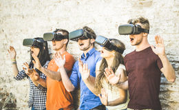 Friends group playing on vr glasses outdoors - Virtual reality. And wearable tech concept with young people having fun together with headset goggles Stock Photography