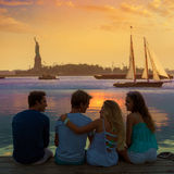 Friends group rear view at sunset fun New York Stock Photos