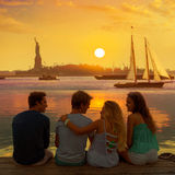 Friends group rear view at sunset fun New York. Friends group rear view at sunset happy fun in New York Manhattan photo mount Stock Images