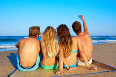 Friends group selfie photo sitting in beach sand Royalty Free Stock Photo