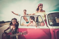 Friends with guitar on a road trip Stock Photo