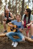 Friends guitar song picnic party nature concept. Traveler lifestyle. Hiking happy moments Stock Photography