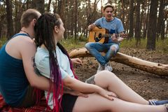 Friends guitar song picnic party nature concept. Traveler lifestyle. Hiking happy moments Stock Image