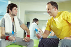 Friends at gym. Two men communicating at gym while resting Stock Image