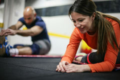 Friends in the gym. Two people stretching in the gym Stock Photos