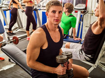Friends in gym workout with fitness equipment. Training men. Stock Images
