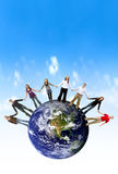Friends hands around the world Royalty Free Stock Photography