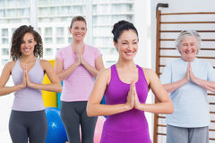 Friends with hands clasped standing in gym Stock Images