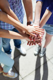 Friends with hands stacked in unison Royalty Free Stock Photos