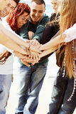 Friends with hands together Royalty Free Stock Photo