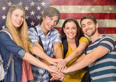 Friends with hands together against american flag Stock Image