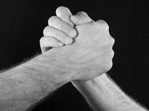 Friends handshake. Closeup black & white image from a handshake between friends Royalty Free Stock Image