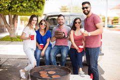 Friends hanging out at a baseball game. Five good  looking Hispanic friends enjoying some burgers and beers outside during a baseball game Royalty Free Stock Photos