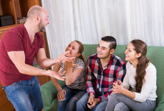 Friends hanging out with beer and jokes Stock Image
