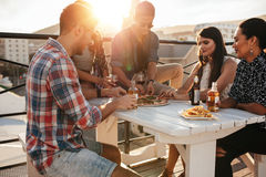 Friends hanging out on the rooftop Stock Image