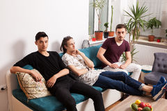 Friends hanging out together in nice confortable room Royalty Free Stock Image