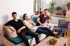 Friends hanging out together in nice confortable room Royalty Free Stock Images