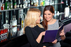 Friends have fun in bar Royalty Free Stock Image