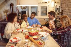 Friends have fun at a family Christmas dinner royalty free stock photos