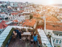 Friends on the Rooftop. Friends have fun on the roof of the house Royalty Free Stock Photo