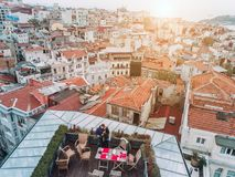Friends on the Rooftop. Friends have fun on the roof of the house Royalty Free Stock Image