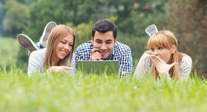 Friends have fun and study homework Stock Photography