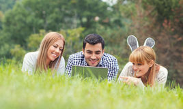 Friends have fun and study homework Stock Photo