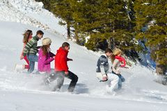 Friends have fun at winter on fresh snow Royalty Free Stock Images
