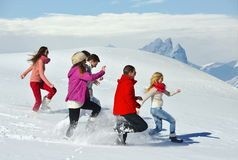Friends have fun at winter on fresh snow Royalty Free Stock Photo